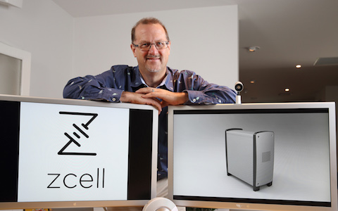 Redflow Executive Chairman Simon Hackett with ZCell enclosure on-screen