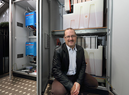 Simon Hackett with his Redflow home energy storage system