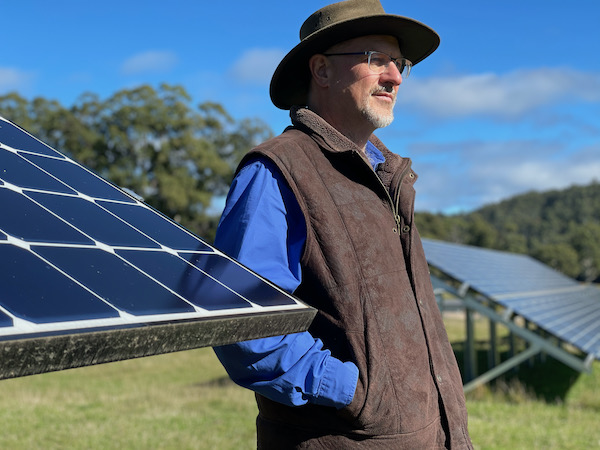 Simon Hackett with solar panel arrays at The Vale